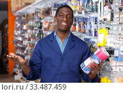 Glad man offering for sale different supplies. Стоковое фото, фотограф Яков Филимонов / Фотобанк Лори