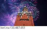 Купить «The Spasskaya Tower and fireworks in honor of Victory Day celebration (WWII), Red Square, Moscow, Russia», фото № 33487651, снято 9 мая 2019 г. (c) Владимир Журавлев / Фотобанк Лори