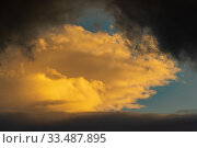 Купить «Dramatic clouds illuminated rising of sun floating in blue sky. Natural weather, meteorology background. Heavenly landscape», фото № 33487895, снято 27 марта 2020 г. (c) А. А. Пирагис / Фотобанк Лори