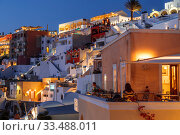 Купить «View of the night Fira with hotels, cafes and restaurants in the evening light. The island of Santorini, Greece», фото № 33488011, снято 9 июня 2017 г. (c) Наталья Волкова / Фотобанк Лори