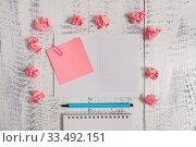 Купить «Squared spiral notepad clip note highlighter paper balls wooden background», фото № 33492151, снято 8 апреля 2020 г. (c) easy Fotostock / Фотобанк Лори