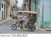 Купить «Bici taxi in Havana Vieja, Havana, Cuba.», фото № 33492827, снято 6 марта 2020 г. (c) age Fotostock / Фотобанк Лори