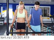 Купить «Couple exercising push-ups on bars», фото № 33501419, снято 16 июля 2018 г. (c) Яков Филимонов / Фотобанк Лори