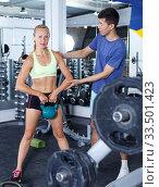 Купить «Couple during weightlifting workout», фото № 33501423, снято 16 июля 2018 г. (c) Яков Филимонов / Фотобанк Лори