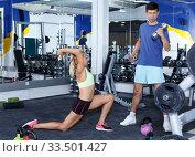 Купить «Couple during weightlifting workout», фото № 33501427, снято 16 июля 2018 г. (c) Яков Филимонов / Фотобанк Лори
