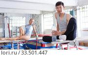 Couple sitting on parallel bars. Стоковое фото, фотограф Яков Филимонов / Фотобанк Лори