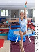 Купить «Happy beautiful woman gymnast training gymnastic action at broad bars», фото № 33501451, снято 18 июля 2018 г. (c) Яков Филимонов / Фотобанк Лори