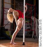 Sexy dance of a beautiful woman in red swimsuit on a pylon. Стоковое фото, фотограф Яков Филимонов / Фотобанк Лори