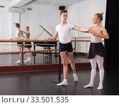 Купить «Choreographer helping young man dancer to have right position. Exercising at the barre by the mirror», фото № 33501535, снято 26 апреля 2019 г. (c) Яков Филимонов / Фотобанк Лори