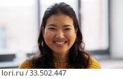 Купить «portrait of happy smiling asian young woman», видеоролик № 33502447, снято 26 марта 2020 г. (c) Syda Productions / Фотобанк Лори