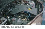 Купить «Auto repair shop - working engine under the car hood», видеоролик № 33502543, снято 30 мая 2020 г. (c) Константин Шишкин / Фотобанк Лори