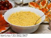 Салат из печени трески стоит на праздничном столе. Стоковое фото, фотограф Игорь Низов / Фотобанк Лори