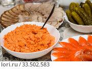 Купить «Салат из морковки с майонезом стоит на праздничном столе», эксклюзивное фото № 33502583, снято 31 декабря 2019 г. (c) Игорь Низов / Фотобанк Лори