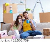 Купить «Young family moving to new apartment», фото № 33506759, снято 10 июля 2017 г. (c) Elnur / Фотобанк Лори