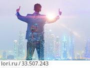 Successful businessman against cityscape in business concept. Стоковое фото, фотограф Elnur / Фотобанк Лори