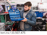 Male is standing with new ratchet. Стоковое фото, фотограф Яков Филимонов / Фотобанк Лори