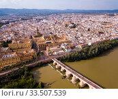 Aerial view of Cordoba with Roman Bridge and Mosque-Cathedral (2019 год). Стоковое фото, фотограф Яков Филимонов / Фотобанк Лори