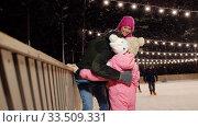Купить «happy family at outdoor skating rink in winter», видеоролик № 33509331, снято 22 марта 2020 г. (c) Syda Productions / Фотобанк Лори