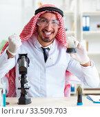 Купить «Arab chemist working in the lab office», фото № 33509703, снято 21 апреля 2018 г. (c) Elnur / Фотобанк Лори