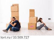 Купить «Young pair and many boxes in divorce settlement concept», фото № 33509727, снято 3 сентября 2019 г. (c) Elnur / Фотобанк Лори