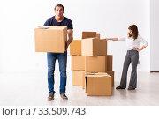 Купить «Young pair and many boxes in divorce settlement concept», фото № 33509743, снято 3 сентября 2019 г. (c) Elnur / Фотобанк Лори