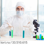 Купить «Young chemist student working in lab on chemicals», фото № 33510615, снято 25 января 2018 г. (c) Elnur / Фотобанк Лори