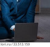 Купить «Businessman working overtime long hours late in office», фото № 33513159, снято 9 октября 2017 г. (c) Elnur / Фотобанк Лори
