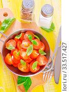 Купить «Tomato with basil», фото № 33517427, снято 9 апреля 2020 г. (c) age Fotostock / Фотобанк Лори