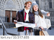 Купить «Man and woman with map and package looking attraction outdoors», фото № 33517655, снято 18 ноября 2017 г. (c) Яков Филимонов / Фотобанк Лори