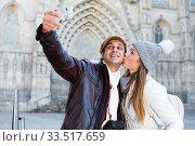 Купить «tourists taking selfie on mobile phone», фото № 33517659, снято 18 ноября 2017 г. (c) Яков Филимонов / Фотобанк Лори
