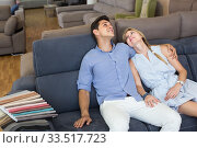 Купить «satisfied man and woman are choosing sofa in store», фото № 33517723, снято 19 июня 2017 г. (c) Яков Филимонов / Фотобанк Лори