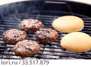 burger meat cutlets roasting on barbecue grill. Стоковое фото, фотограф Syda Productions / Фотобанк Лори