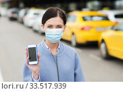Купить «woman in face mask with smartphone in city», фото № 33517939, снято 10 мая 2015 г. (c) Syda Productions / Фотобанк Лори