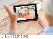 grandmother having video call with granddaughter. Стоковое фото, фотограф Syda Productions / Фотобанк Лори