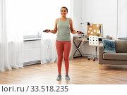 Купить «african woman exercising with jump rope at home», фото № 33518235, снято 25 марта 2020 г. (c) Syda Productions / Фотобанк Лори
