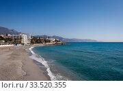 City beach in the resort of Nerja, Andalusia, Spain, Europe. Редакционное фото, агентство Caro Photoagency / Фотобанк Лори