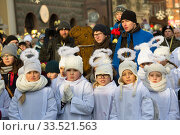 Купить «Poland, Poznan - Epiphany Day is officially celebrated at the Old Market Square. Girls dressed as angels.», фото № 33521563, снято 6 января 2017 г. (c) Caro Photoagency / Фотобанк Лори