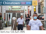 Купить «Singapore, Republic of Singapore, Passers-by with mouthguards in the Chinatown district», фото № 33521995, снято 28 февраля 2020 г. (c) Caro Photoagency / Фотобанк Лори