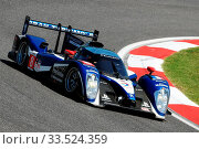Imola, Italy 3 July 2011: Peugeot 908 HDI Fap 2011 LMP1 of Team Peugeot Sport Total driven by Frank Montagny and Stephane Sarrazin in action during Race 6H ILMC at Imola Circuit. Редакционное фото, фотограф Daniele Ciabatti / age Fotostock / Фотобанк Лори