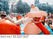 Купить «Russia, Samara, August, 2018: Russian folk fun wrestling with inflatable logs inflatable mattresses on the Volga River Embankment on a summer sunny day», фото № 33527527, снято 11 августа 2018 г. (c) Акиньшин Владимир / Фотобанк Лори