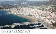 Купить «View from drone on boats and yachts in Mediterranean coastal town and resort of Roses in Catalonia, Spain», видеоролик № 33527939, снято 10 февраля 2019 г. (c) Яков Филимонов / Фотобанк Лори