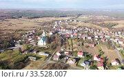 Купить «Flight over the village Wlodowice. Poland», видеоролик № 33528007, снято 13 марта 2020 г. (c) Яков Филимонов / Фотобанк Лори