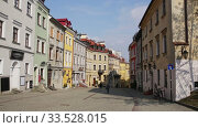 View of traditional colored tenements houses on central streets of Polish city of Lublin in sunny spring day. Стоковое видео, видеограф Яков Филимонов / Фотобанк Лори