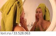 Купить «Happy young woman with towel at mirror in bathroom», видеоролик № 33528063, снято 30 сентября 2019 г. (c) Яков Филимонов / Фотобанк Лори