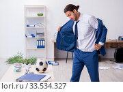 Купить «Young male employee playing football in the office», фото № 33534327, снято 13 сентября 2019 г. (c) Elnur / Фотобанк Лори