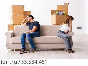 Купить «Young pair and many boxes in divorce settlement concept», фото № 33534451, снято 3 сентября 2019 г. (c) Elnur / Фотобанк Лори