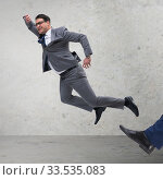 Купить «Bad angry boss kicking employee in business concept», фото № 33535083, снято 5 июля 2020 г. (c) Elnur / Фотобанк Лори