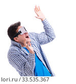 Купить «Young man wearing virtual reality VR glasses», фото № 33535367, снято 27 мая 2017 г. (c) Elnur / Фотобанк Лори