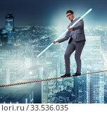 Купить «Businessman doing tightrope walking in risk concept», фото № 33536035, снято 20 декабря 2013 г. (c) Elnur / Фотобанк Лори