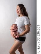 Pretty little thing. Mother holding her baby. Close up. Стоковое фото, фотограф Василий Кочетков / Фотобанк Лори